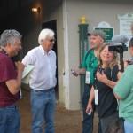 Trainer Bob Baffert jokes with reporters