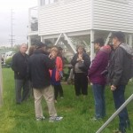 Gathering at the fence to hear Churchill Downs history